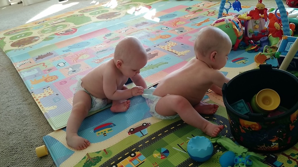 twins playing in babyproofed room